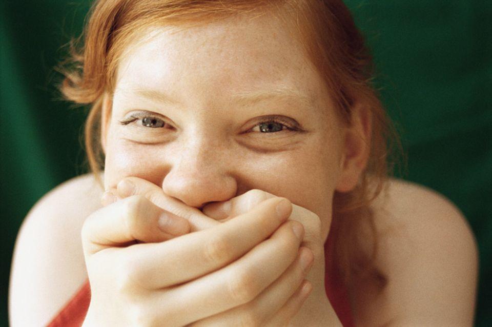 Redewendung: Ins Fäustchen lachen
