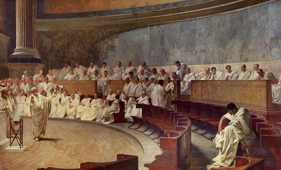 Anfang November 63 v. Chr. hält Cicero vor dem Senat eine flammende Rede gegen seinen Rivalen, den adeligen Verschwörer Catilina. Er fordert den im Rat Anwesenden auf, sich endlich als Staatsfeind zu bekennen - und Rom zu verlassen