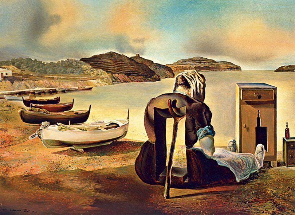 """Surrealismus: Fast wie eine Fotografie des Unmöglichen erscheint """"Die Entwöhnung von der Möbelnahrung"""", denn Dalí malt die Strandszene 1934 ganz naturgetreu – obwohl der Frau ein Stück Torso fehlt"""