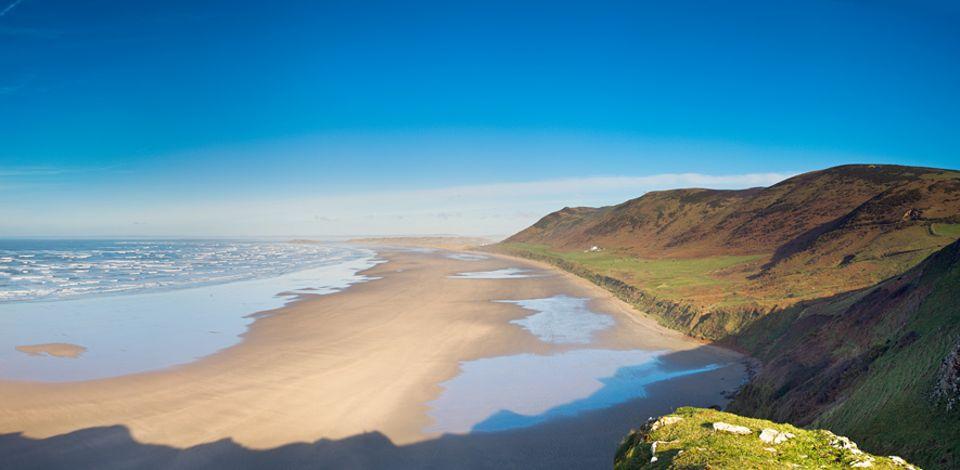 Großbritanniens Westen: Wunderschönes Wales - der Strand der Rhossili Bay zählt zu den schönsten der Region