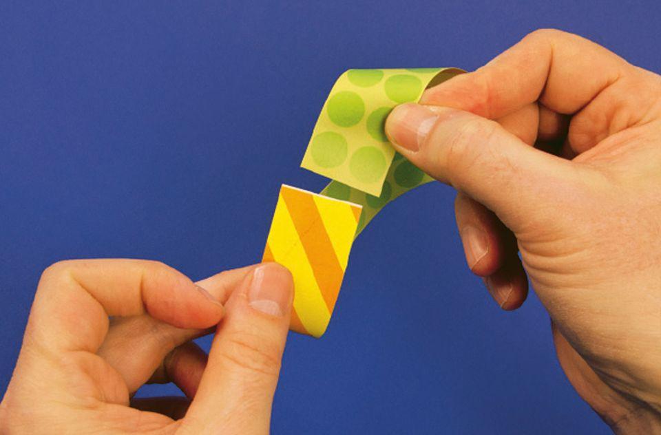 Mathematik: Am besten ist euer Streifen auf beiden Seiten unterschiedlich gefärbt oder gemustert