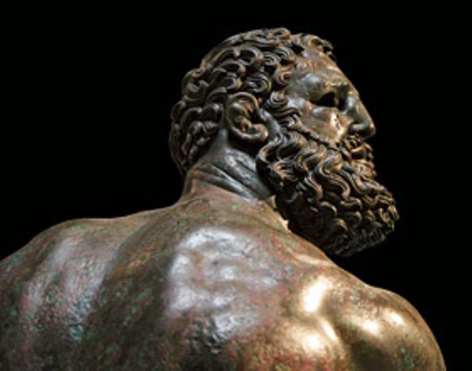 Ein Werk und seine Geschichte: Die Spuren des Kampfes: Jeder sichtbare Muskel, wie hier an den Schultern, betont die Kraft des Athleten. Doch das geschwollene Gesicht und die deformierten Ohren zeigen: Auch die Gegner haben getroffen