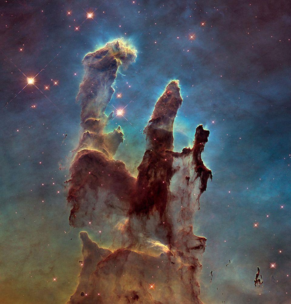 """Kosmos: Geburtsstätte der Sterne: die """"Säulen der Schöpfung"""" im Adlernebel"""