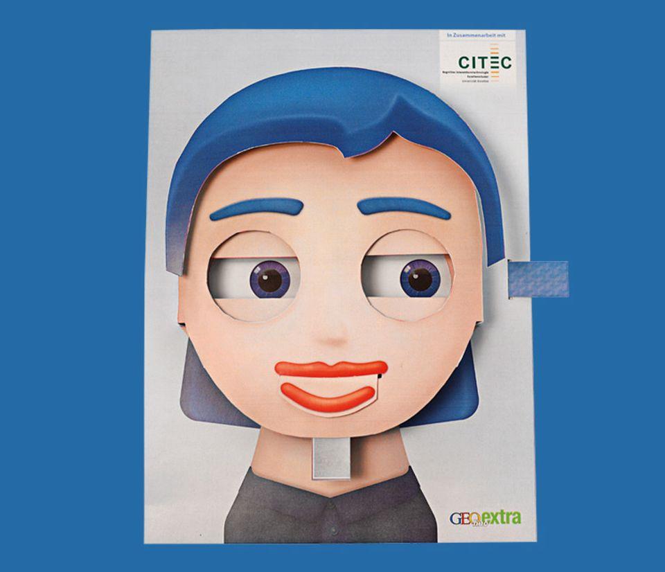 Basteltipp: So sieht der fertige Papproboter Flobi aus. Je nachdem wie seine Augen und Mund gestellt sind, zeigt er ganz unterschiedliche Stimmungen an