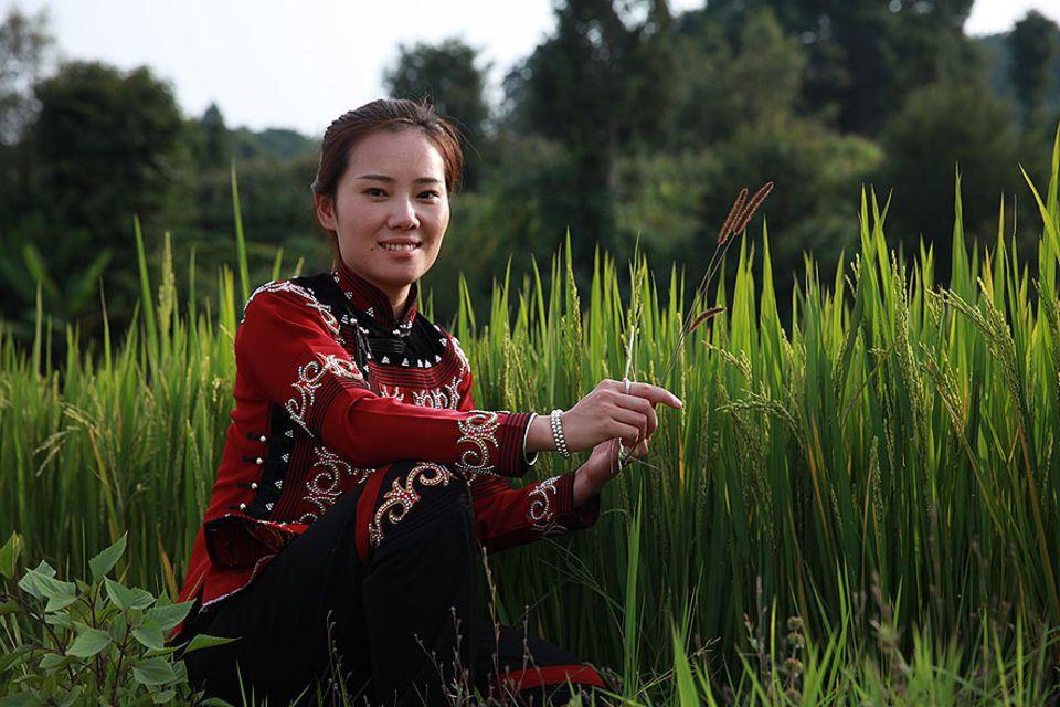 Die 25jährige Meiyun im traditionellen Reisfeld