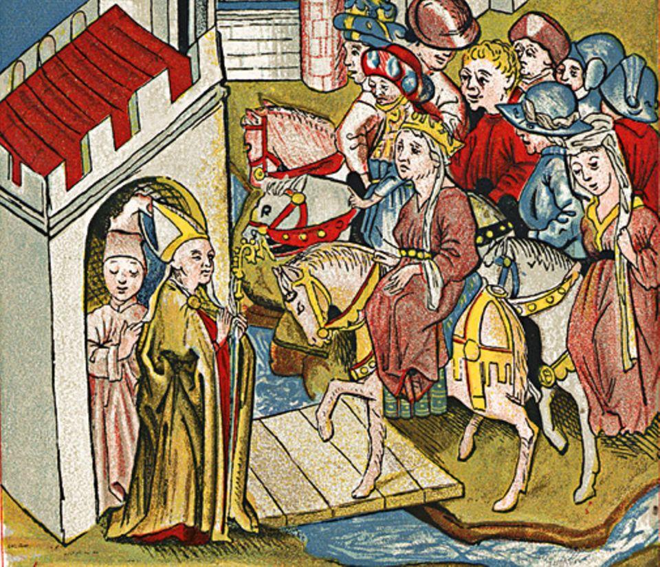 Die Völkerwanderung: Nach dem Tod ihres Gatten Siegfried heiratet die Sagengestalt Kriemhild (im Bild links) den bekrönten Hunnenherrscher Etzel (Buchmalerei, 15. Jh.)