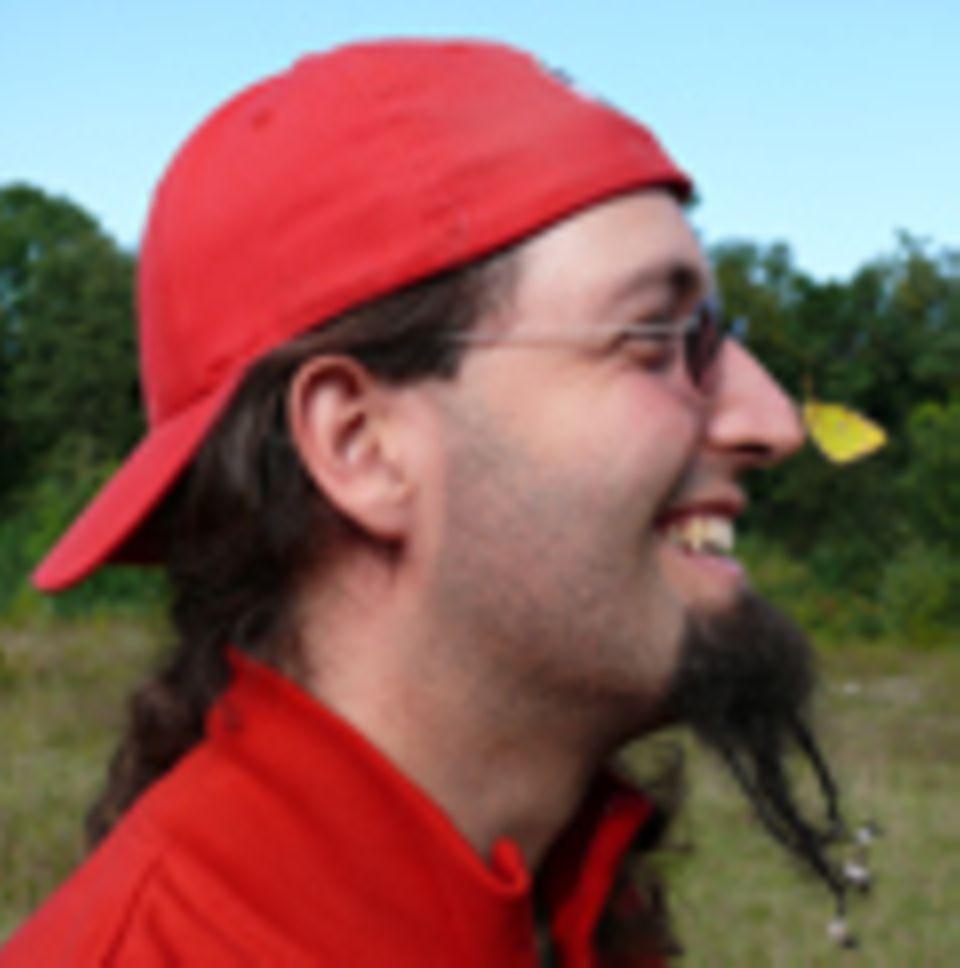 Fotogalerie: Arik Siegel mit einem Gelbling - ganz dicht vor der Linse