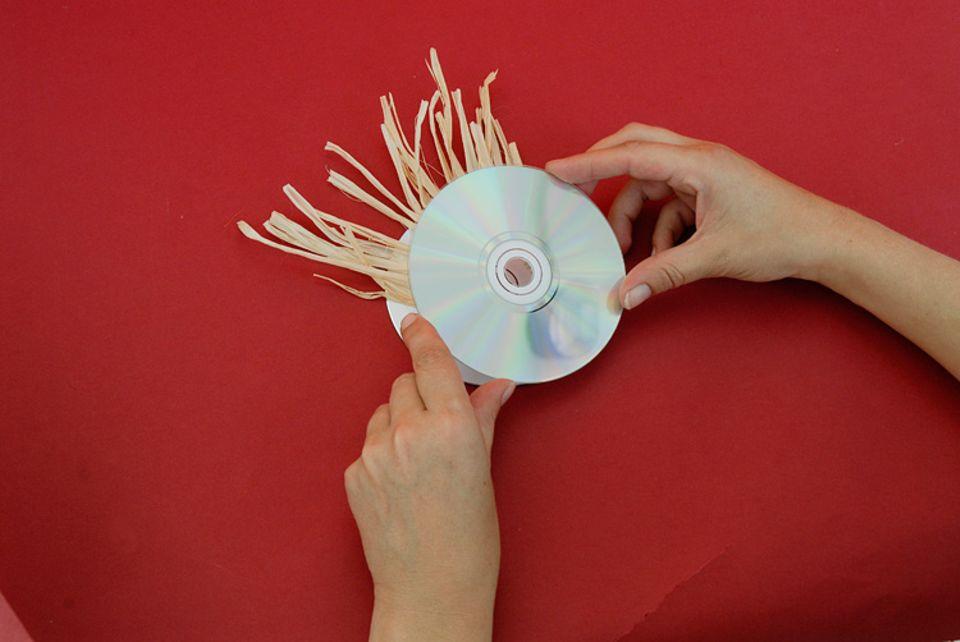 Garten: Schillernde Vogelscheuchen aus CDs