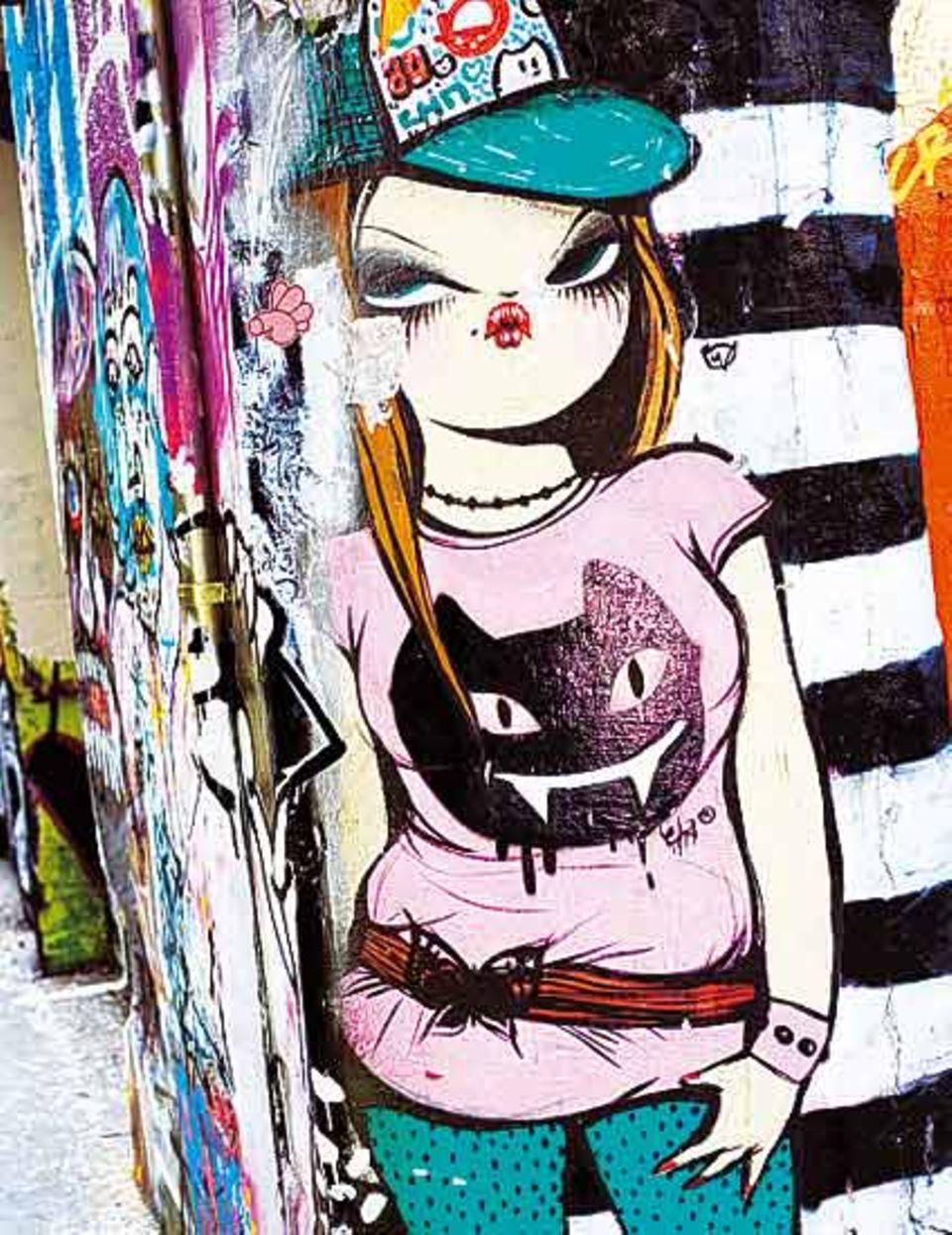 Junges Leben in Raval - auch Graffitis zogen hier ein