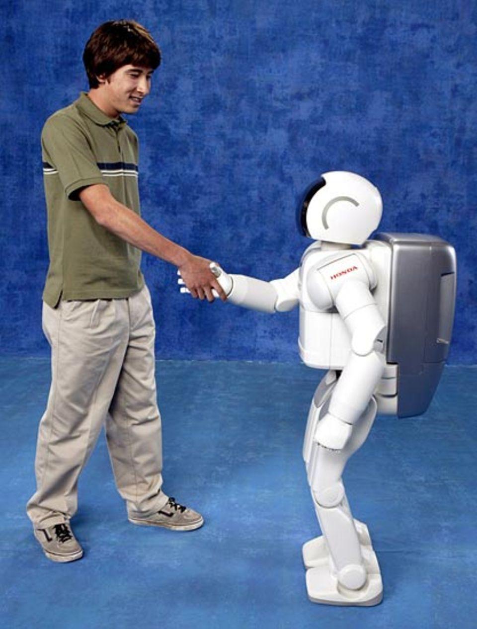 Technik: Asimo kann sogar richtigen Menschen die Hand schütteln