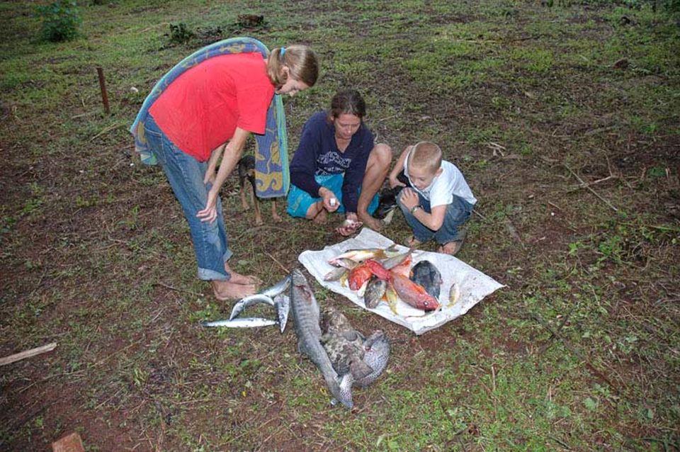 Stolze Angler mit ihrer reichen Beute