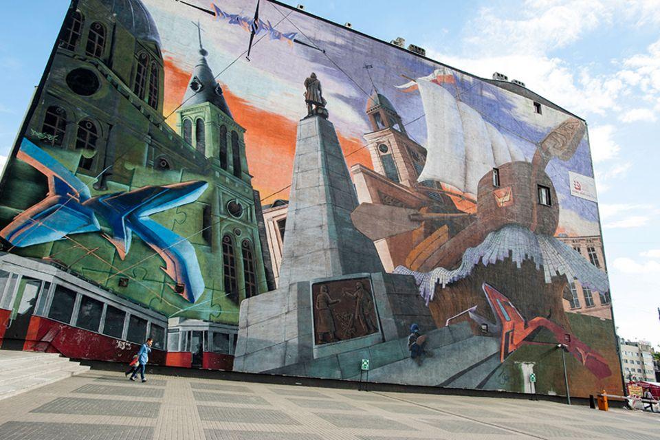 Polen: Graffitis an der Piotrowska-Strasse, selbst sie sind auf die Textilindustrie der Stadt zurückzuführen