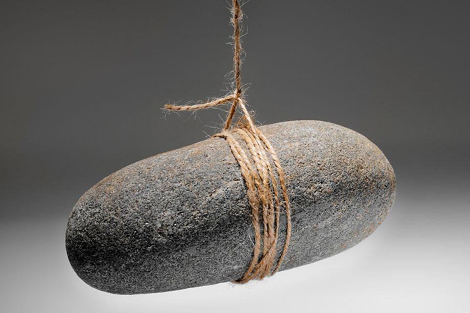 Redewendung: Am seidenen Faden hängen