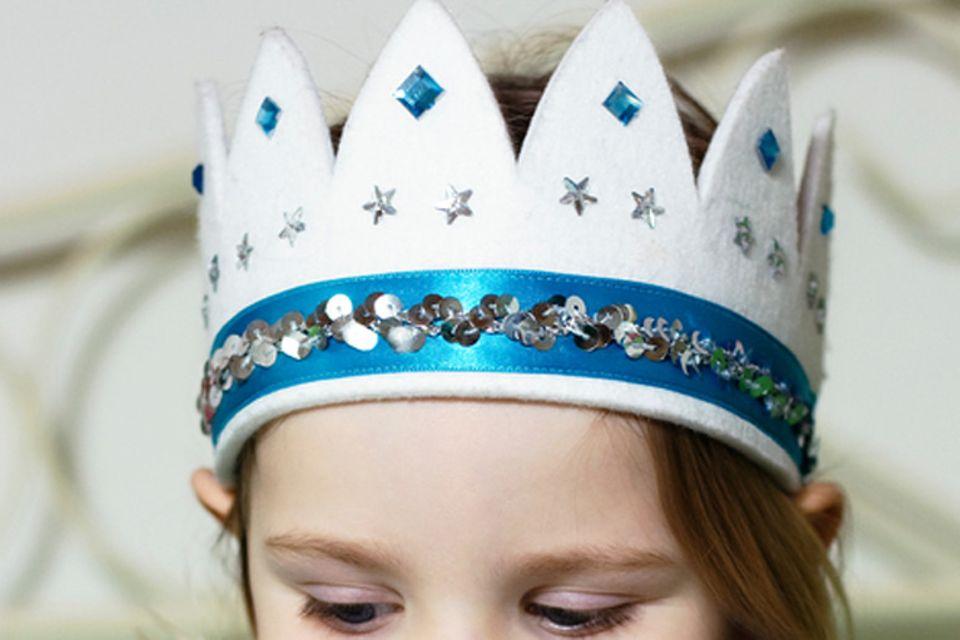 Redewendung: Einer Sache die Krone aufsetzen