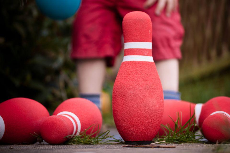 Redewendung: Mit Kind und Kegel