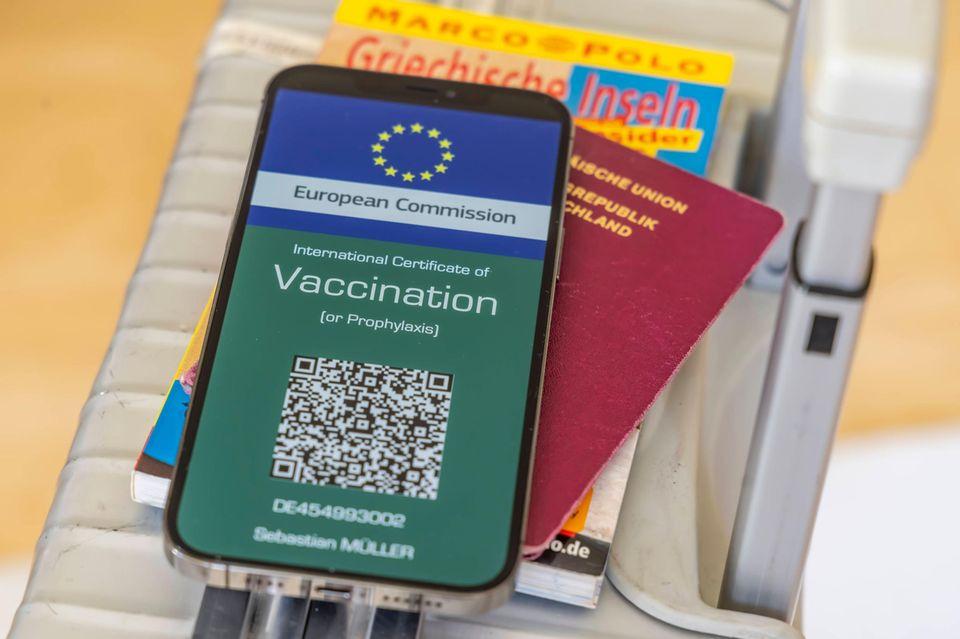 Digitaler Impfnachweis auf dem Koffer