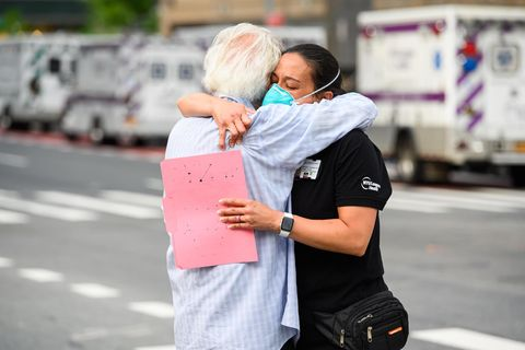 NEW YORK, NEW YORK - MAY 29: A medical worker hugs a COVID-19 survivor outside NYU Langone Health hospital during the coronavirus pandemic on May 29, 2020 in New York City. Government guidelines encourage wearing a mask in public with strong social dist...